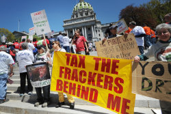 Anti-fracking demonstrators protest on the steps of the state capitol on Tuesday, May 6, 2014, in Harrisburg, Pa.