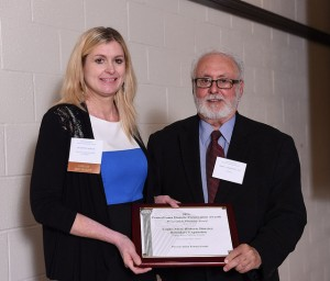 Shannon Baker, PEMA President, accepts the 2014 Preservation Planning Award fromJohn A. Martine of the Preservation Pennsylvania Board at a luncheon on September 23 at Juniata College in Huntingdon, PA.